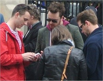 Treasure Hunters using phone for hunting with Treasure Hunts in London