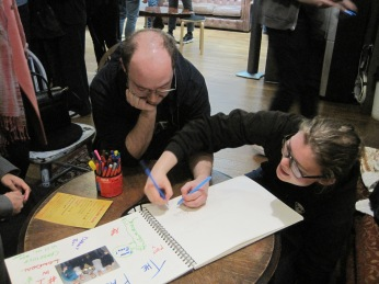 Designing our winning page at ClueQuest - photo by Juliamaud