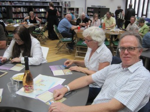 Studying the information at A Taste Of Murder - photo by Juliamaud
